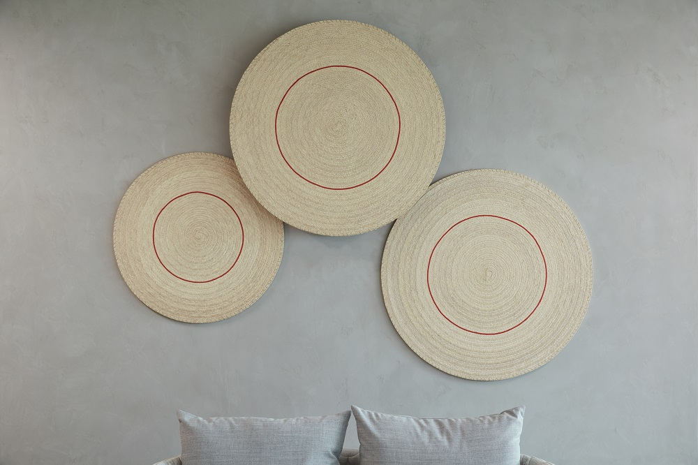Bed with three circle patterns on the wall for Mental Health Blog
