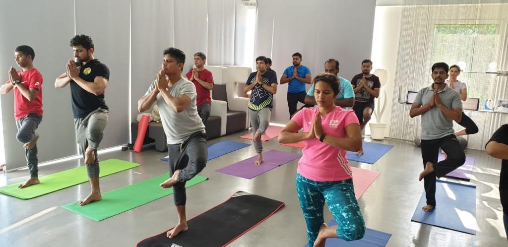 Summertown Employees doing Yoga Pose